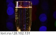 Купить «Glass with champagne in front of black background with colorful flashing lights», видеоролик № 28102131, снято 12 февраля 2016 г. (c) Алексей Кузнецов / Фотобанк Лори