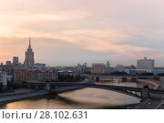 Купить «Smolensky Metro Bridge with moving train at evening in Moscow, Russia», фото № 28102631, снято 1 августа 2014 г. (c) Losevsky Pavel / Фотобанк Лори