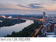 Купить «Bridge and river among trees in residential area in Moscow, Russia at summer evening», фото № 28102695, снято 7 августа 2015 г. (c) Losevsky Pavel / Фотобанк Лори