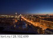 Купить «MOSCOW - AUG 20, 2015: Man stands on roof on Ground shaft street near Great Krasnokholmsky Bridge during sunset», фото № 28102699, снято 20 августа 2015 г. (c) Losevsky Pavel / Фотобанк Лори