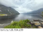 Купить «Foggy weather over the Eidfjorden, Norway, Scandinavia, village Eidfjord.», фото № 28104239, снято 2 июля 2017 г. (c) age Fotostock / Фотобанк Лори
