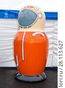 Купить «Big matryoshka doll also known as a Russian nesting doll as a cosmonaut», фото № 28113627, снято 4 ноября 2017 г. (c) FotograFF / Фотобанк Лори