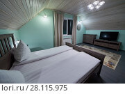 Купить «Interior of room with double bed, carpet, tv set in hotel», фото № 28115975, снято 3 февраля 2017 г. (c) Losevsky Pavel / Фотобанк Лори