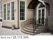 Купить «House of bricks, stone steps of porch with metal handrails and entrance canopy in winter», фото № 28115995, снято 4 февраля 2017 г. (c) Losevsky Pavel / Фотобанк Лори