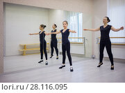 Купить «Woman and girl in black do exercises at ballet bar in hall with mirror», фото № 28116095, снято 14 февраля 2017 г. (c) Losevsky Pavel / Фотобанк Лори