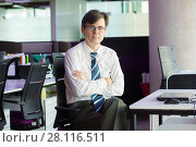 Купить «Handsome man in tie and glasses sits at table with laptop in modern office», фото № 28116511, снято 20 ноября 2016 г. (c) Losevsky Pavel / Фотобанк Лори