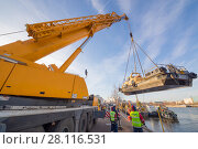 Купить «MOSCOW - NOV 21, 2016: Lifting of ship with crane to shore for organization of inter-navigational sludge and repairs during closure of navigation of Mosvodostok technical fleet», фото № 28116531, снято 21 ноября 2016 г. (c) Losevsky Pavel / Фотобанк Лори