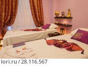 Купить «Empty pink cozy room with two beds for thai massage and asian decoration», фото № 28116567, снято 12 декабря 2016 г. (c) Losevsky Pavel / Фотобанк Лори