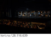 Купить «MOSCOW - JAN 25, 2017: Prisoners on stage and orchestra pit at Passenger performance in Moscow Theater New Opera», фото № 28116639, снято 25 января 2017 г. (c) Losevsky Pavel / Фотобанк Лори