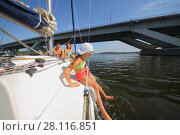 Купить «Father, mother and daughter sail on yacht on river under bridge at summer, focus on child», фото № 28116851, снято 19 августа 2016 г. (c) Losevsky Pavel / Фотобанк Лори
