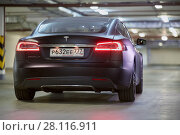 Купить «MOSCOW, RUSSIA - NOV 11, 2015: Tesla S car stands at underground parking. The Tesla Model S produced by Tesla Motors, and introduced in June 2012.», фото № 28116911, снято 11 ноября 2015 г. (c) Losevsky Pavel / Фотобанк Лори