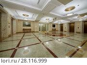 Купить «MOSCOW, RUSSIA - NOV 13, 2015: Empty hall at Radisson Royal Ukraine hotel. Radisson Royal Ukraine hotel is one of seven Stalin skyscrapers.», фото № 28116999, снято 13 ноября 2015 г. (c) Losevsky Pavel / Фотобанк Лори