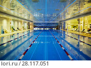 Купить «MOSCOW, RUSSIA - NOV 14, 2015: Swimming pool with dividers and lounges at poolside in Radisson Royal Ukraine hotel», фото № 28117051, снято 14 ноября 2015 г. (c) Losevsky Pavel / Фотобанк Лори