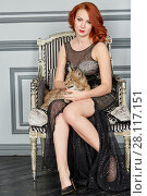 Купить «Red-haired woman sits in armchair with lynx cub on her knees», фото № 28117151, снято 14 ноября 2015 г. (c) Losevsky Pavel / Фотобанк Лори