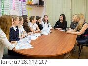 Купить «Three teachers are sitting at table and talking to their seven students in classroom», фото № 28117207, снято 28 апреля 2015 г. (c) Losevsky Pavel / Фотобанк Лори