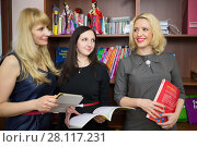 Купить «Three teachers are standing with a books in a hands», фото № 28117231, снято 28 апреля 2015 г. (c) Losevsky Pavel / Фотобанк Лори
