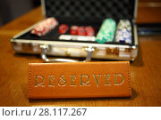 Купить «Carrying case with casino chips and Reserved inscription are on table», фото № 28117267, снято 28 февраля 2016 г. (c) Losevsky Pavel / Фотобанк Лори