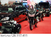 Купить «MOSCOW - MAR 07, 2016: Black car, bikes of cortege with blinkers at exhibition Oldtimer-Gallery in Sokolniki Exhibition Center. It is only one in Russia exhibition of vintage cars and technical antiques», фото № 28117411, снято 7 марта 2016 г. (c) Losevsky Pavel / Фотобанк Лори