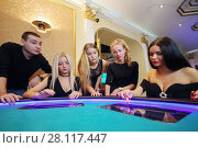 Купить «Four pretty women and man play poker in casino with electronic table», фото № 28117447, снято 24 октября 2016 г. (c) Losevsky Pavel / Фотобанк Лори