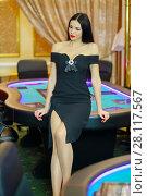 Купить «Young beautiful brunette poses near poker electronic table in luxury casino», фото № 28117567, снято 24 октября 2016 г. (c) Losevsky Pavel / Фотобанк Лори