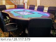 Купить «Modern empty hall in casino with electronic poker table and soft armchairs», фото № 28117579, снято 24 октября 2016 г. (c) Losevsky Pavel / Фотобанк Лори