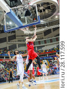 Купить «MOSCOW - JAN 27, 2017: Man jumps during basketball game CSKA (Moscow) - Anadolu Efes (Istanbul) in Megasport stadium», фото № 28117599, снято 27 января 2017 г. (c) Losevsky Pavel / Фотобанк Лори