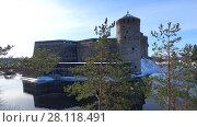 Купить «Мартовский день у старинной крепости Олавинлинна. Савонлинна, Финляндия», видеоролик № 28118491, снято 3 марта 2018 г. (c) Виктор Карасев / Фотобанк Лори