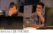 Купить «creative team with computer working late at office», видеоролик № 28118503, снято 29 января 2018 г. (c) Syda Productions / Фотобанк Лори