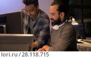 Купить «creative team with computer works at night office», видеоролик № 28118715, снято 29 января 2018 г. (c) Syda Productions / Фотобанк Лори