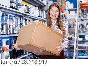 Купить «Portrait of glad young woman with box», фото № 28118919, снято 12 декабря 2017 г. (c) Яков Филимонов / Фотобанк Лори