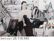 Купить «woman with infant's car cradle», фото № 28118943, снято 19 декабря 2017 г. (c) Яков Филимонов / Фотобанк Лори