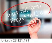 Купить «Man Hand writing Work But Don't Forget to Live with black marker on visual screen», фото № 28121191, снято 13 ноября 2018 г. (c) easy Fotostock / Фотобанк Лори