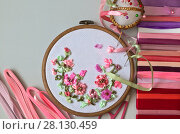 Купить «Embroidery process with satin ribbons of spring flowers in a gentle pink color», фото № 28130459, снято 27 февраля 2018 г. (c) Виктория Катьянова / Фотобанк Лори