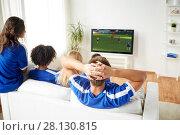 Купить «football fans watching soccer game on tv at home», фото № 28130815, снято 14 августа 2016 г. (c) Syda Productions / Фотобанк Лори