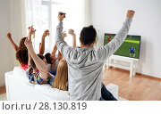 Купить «friends watching soccer on tv and celebrating goal», фото № 28130819, снято 14 августа 2016 г. (c) Syda Productions / Фотобанк Лори