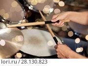 Купить «male musician hands with drumsticks at concert», фото № 28130823, снято 18 августа 2016 г. (c) Syda Productions / Фотобанк Лори
