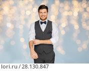 Купить «happy man in festive suit dressing for party», фото № 28130847, снято 15 декабря 2017 г. (c) Syda Productions / Фотобанк Лори
