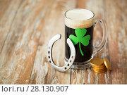 Купить «shamrock on glass of beer, horseshoe and coins», фото № 28130907, снято 31 января 2018 г. (c) Syda Productions / Фотобанк Лори