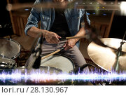 Купить «drummer playing drum kit at sound recording studio», фото № 28130967, снято 18 августа 2016 г. (c) Syda Productions / Фотобанк Лори