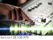 Купить «hands on mixing console in music recording studio», фото № 28130975, снято 18 августа 2016 г. (c) Syda Productions / Фотобанк Лори