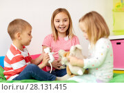 Купить «happy kids playing with plush toys at home», фото № 28131415, снято 15 октября 2017 г. (c) Syda Productions / Фотобанк Лори