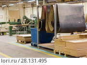 Купить «wooden boards at workshop or woodworking plant», фото № 28131495, снято 10 ноября 2017 г. (c) Syda Productions / Фотобанк Лори