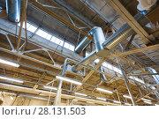 Купить «ventilation pipes at factory shop», фото № 28131503, снято 10 ноября 2017 г. (c) Syda Productions / Фотобанк Лори