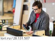 Купить «assembler with screwdriver making furniture», фото № 28131507, снято 10 ноября 2017 г. (c) Syda Productions / Фотобанк Лори