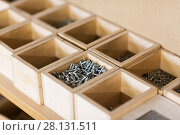 Купить «screws in wooden boxes at workshop», фото № 28131511, снято 10 ноября 2017 г. (c) Syda Productions / Фотобанк Лори