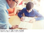 Купить «group of students and teacher at school classroom», фото № 28131539, снято 22 апреля 2016 г. (c) Syda Productions / Фотобанк Лори