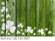Купить «shamrock pattern on old green wooden boards», фото № 28131567, снято 30 сентября 2015 г. (c) Syda Productions / Фотобанк Лори