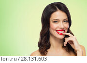 Купить «beautiful smiling young woman with red lipstick», фото № 28131603, снято 5 января 2018 г. (c) Syda Productions / Фотобанк Лори