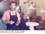 Купить «smiling man hairdresser and woman in salon», фото № 28132219, снято 25 сентября 2018 г. (c) Яков Филимонов / Фотобанк Лори