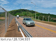 Купить «Traffic vehicles, Highway SP-344, 2017, Caconde, Sao Paulo, Brazil.», фото № 28134931, снято 11 декабря 2017 г. (c) age Fotostock / Фотобанк Лори
